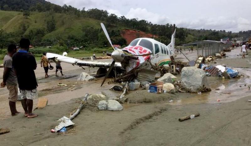 At least 107 killed in Indonesia's flash floods, landslides, 93 still missing